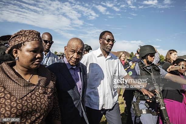 Lesotho Prime Minister Tom Thabane leaves on February 28, 2015 a polling station on the outskirts of Maseru after voting in a snap election, six...