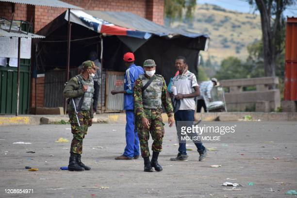 Lesotho soldiers are seen on the streets of Maseru on March 30 2020 enforcing the lockdown ordered by Prime Minister Thomas Thabane Lesotho entered...