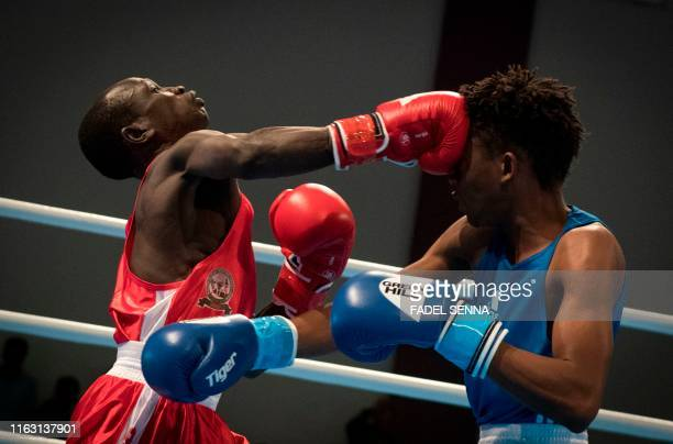 TOPSHOT Lesotho's Mokhesi Tlholohelo and South Sudan's Hal Hal compete during the men's light boxing competition in 12th edition of the African Games...