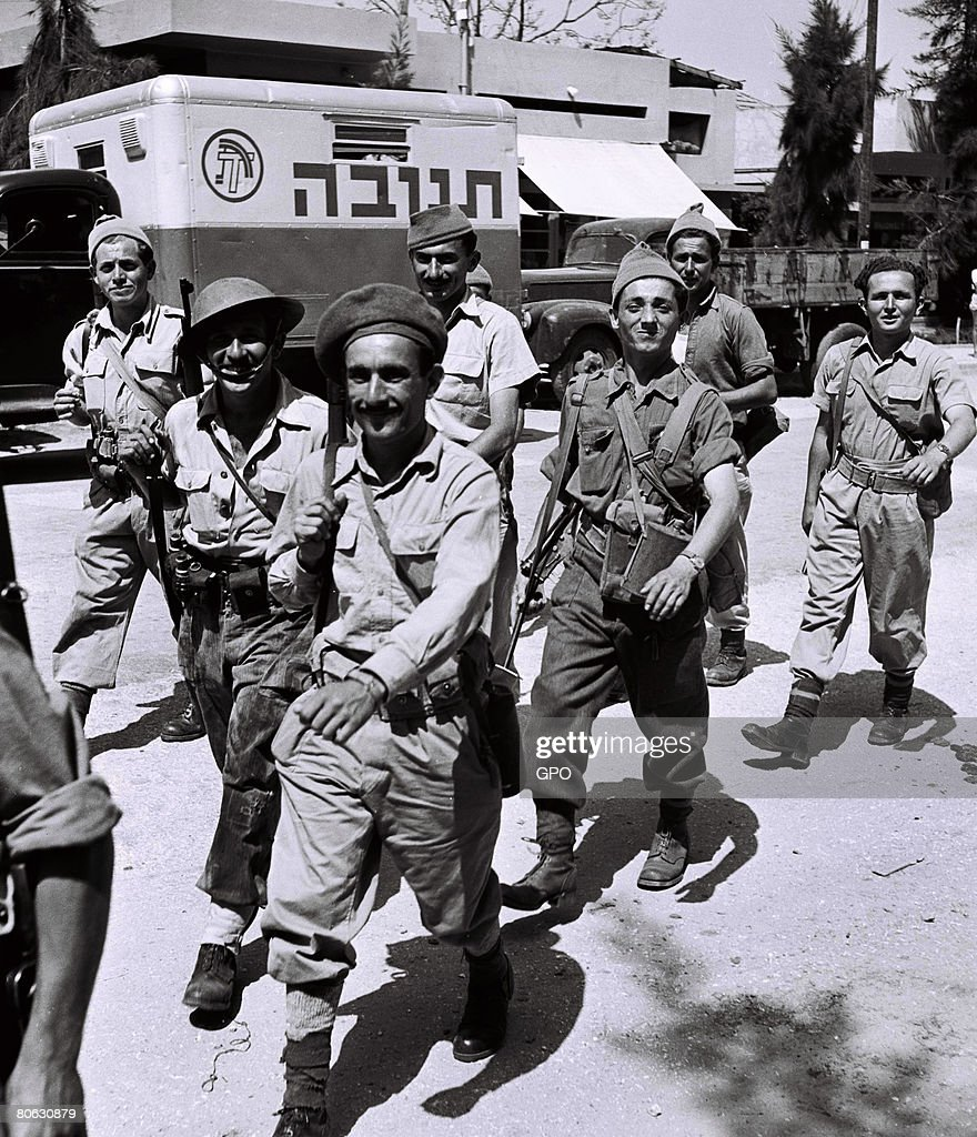 Less than 2 weeks before Israel's declaration of independence, fighters from the Haganah, the Jewish underground, walk proudly through the streets on May 5, 1948, in Tel Aviv in the British Mandate for Palestine.
