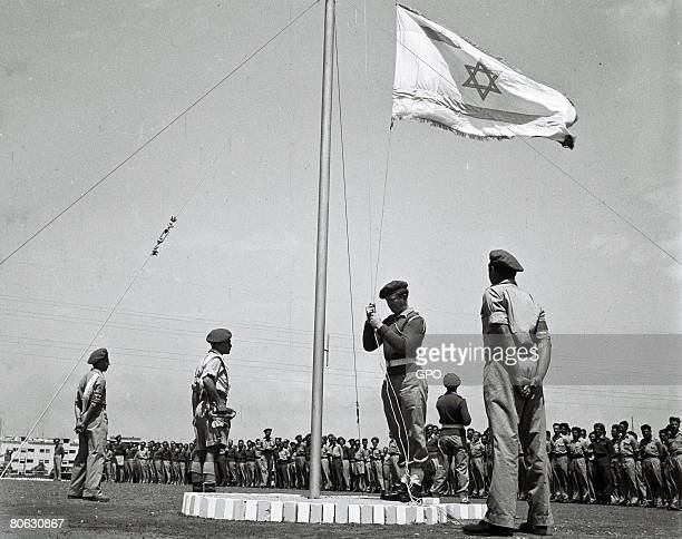 Less than 3 weeks before Israel's independence, the flag of the future Jewish State is raised at morning parade at a training base of the fledgling...