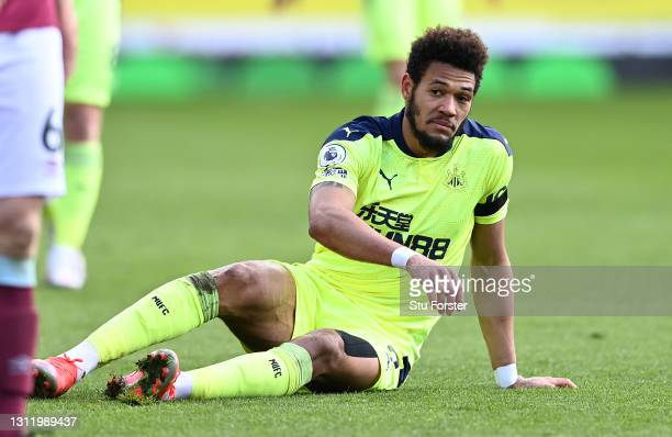 Less than impressed Joelinton of Newcastle looks on from the floor during the Premier League match between Burnley and Newcastle United at Turf Moor...