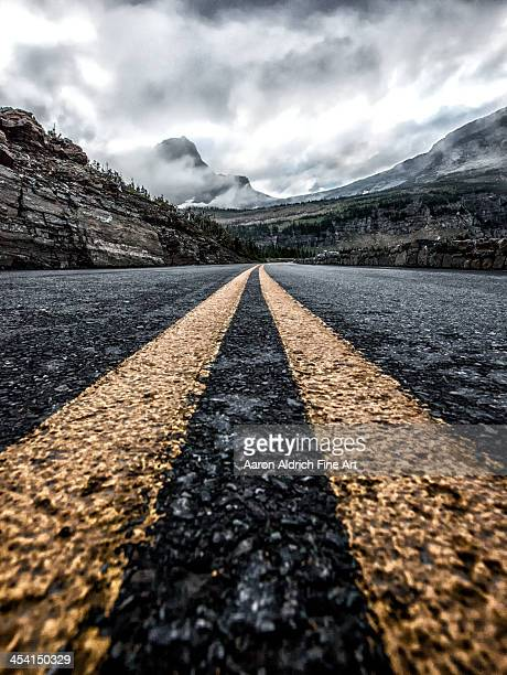 less traveled - double yellow line stock photos and pictures
