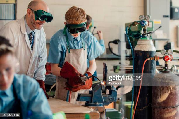 stem lesson in school - welding stock photos and pictures