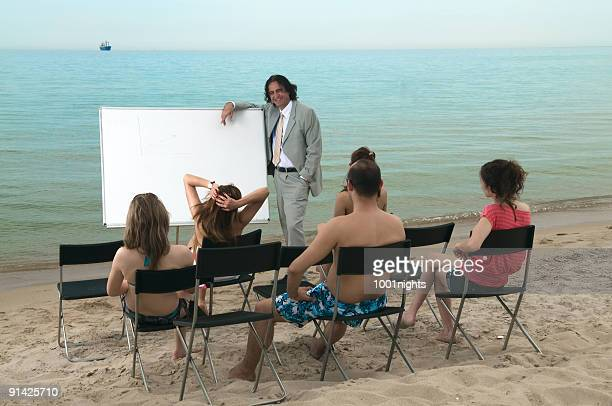 lesson on the beach - free business coaching stock pictures, royalty-free photos & images