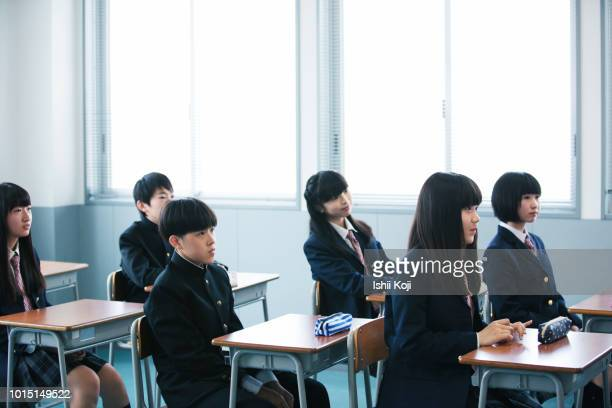 lesson scene of junior high school students - 制服 ストックフォトと画像
