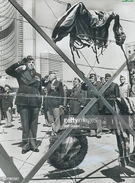 Lest We Forget ù Nazi Horror Grim reminders of concentration camp horrors ù a simulated electric fence with prisoners' garb impaled on barbed wire ù...