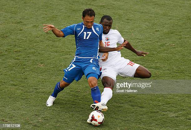 Lester Blanco Pineda of El Salvador battles for the ball with Jean Marc Alexandre of Haiti during the CONCACAF Gold Cup game at BBVA Compass Stadium...