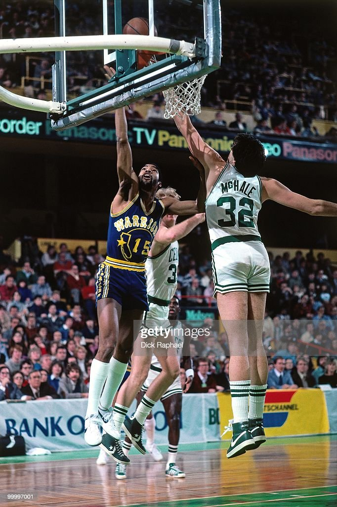 Lester Conner #15 of the Golden State Warriors shoots a layup against Kevin McHale #32 of the Boston Celtics during a game played in 1983 at the Boston Garden in Boston, Massachusetts.