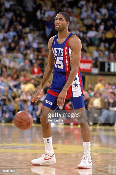 Lester Conner of the New Jersey Nets dribbles the ball midcourt during the NBA game against the Los Angeles Lakers at the Great Western Forum in Los...