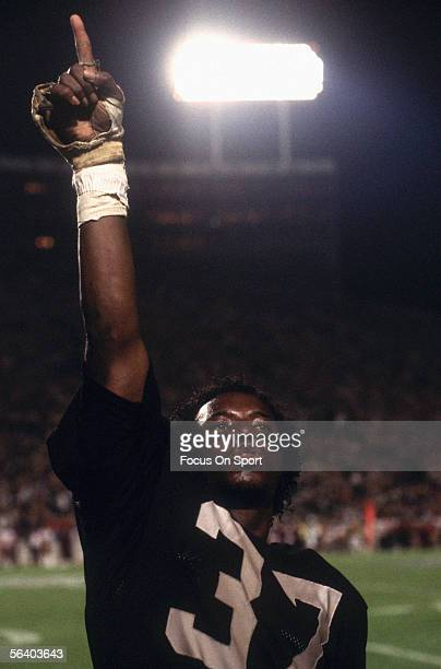 Lester Hayes Defencive back for the Oakland Raiders gestures to the crowd for support during Super Bowl XVIII against the Washington Redskins at...