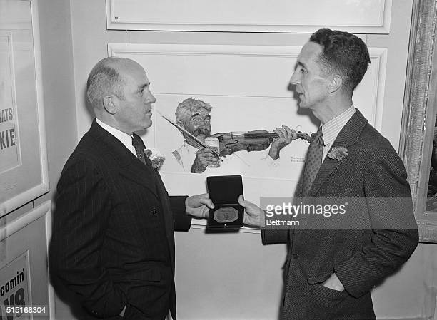 Lester Jay Loh , President of the Art Directors Club, presenting the Kerwin H. Fulton medal to Norman Rockwell, noted artist, for the painting which...