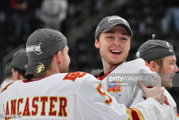 Lester Lancaster and Filip Larsson of the Denver Pioneers celebrate after defeating the American International Yellow Jackets 30 in the NCAA Division...