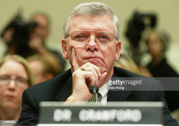 Lester M Crawford deputy commissioner of the US Food and Drug Administration pauses during testimony at a hearing October 10 2002 in Washington DC...
