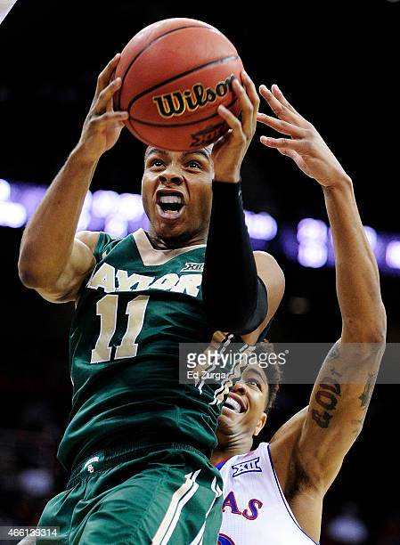 Lester Medford of the Baylor Bears goes up against Kelly Oubre Jr #12 of the Kansas Jayhawks in the first half during a semifinal game of the 2015...