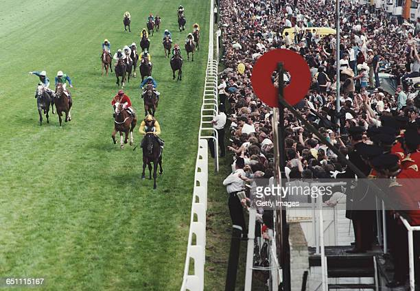 Lester Piggott of Great Britain riding Teenoso beats Carlingford Castle ridden by Mick Kinane into second place to win the 204th annual running of...