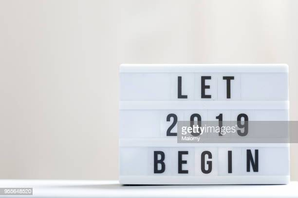 let 2019 begin: happy new year sign. - 2019 foto e immagini stock