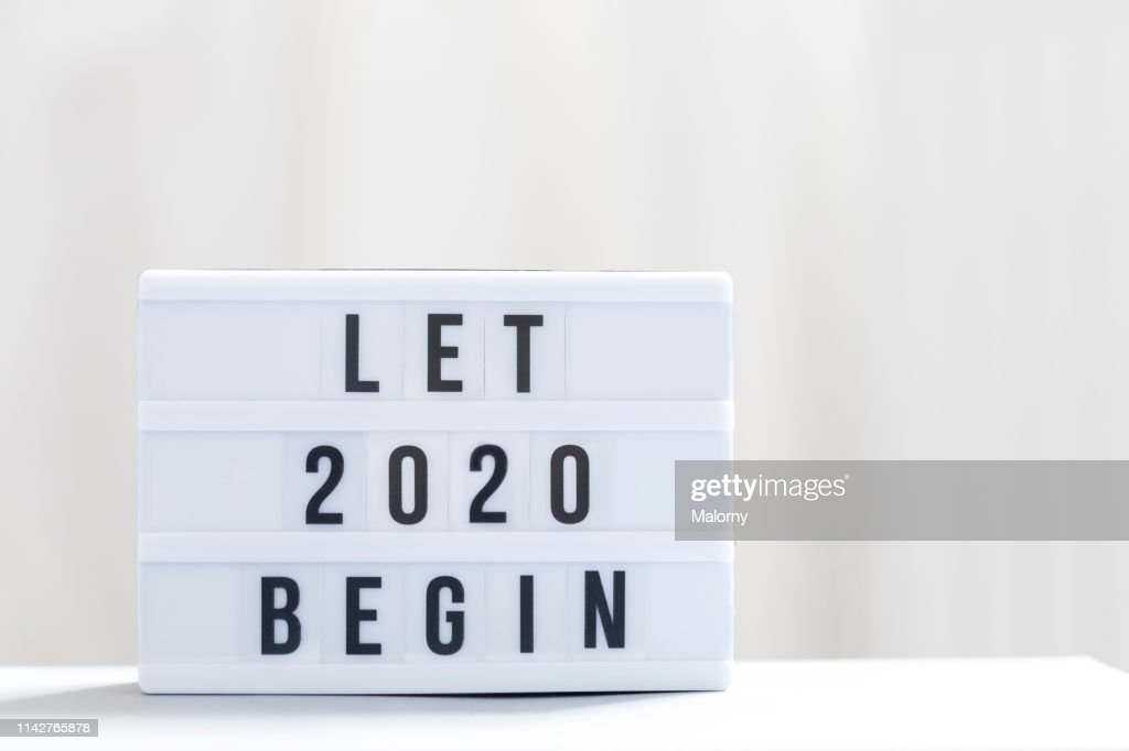 Let 2020 begin: Happy New Year Sign. : Stock Photo