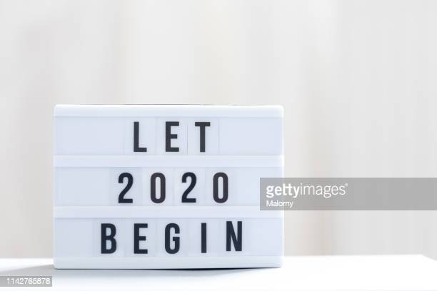 let 2020 begin: happy new year sign. - dia de ano novo imagens e fotografias de stock