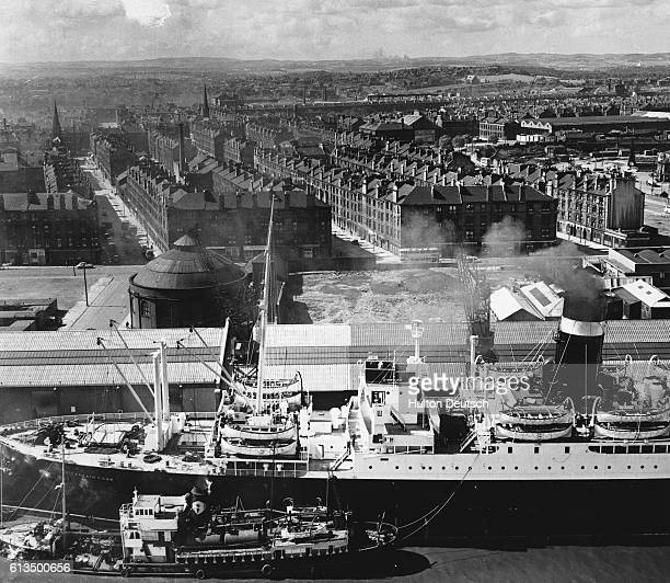 Let Glasgow flourish Liner docking at Mavisbank Quay in Glasgow Scotland 1955 The Clydeside is the heaviest industrial concentration in history and...