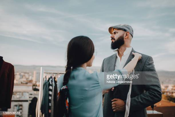 let me assist you - menswear stock pictures, royalty-free photos & images