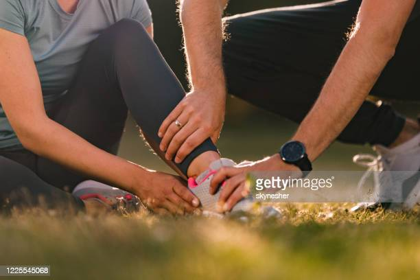 let me help you with that injured ankle! - athleticism stock pictures, royalty-free photos & images