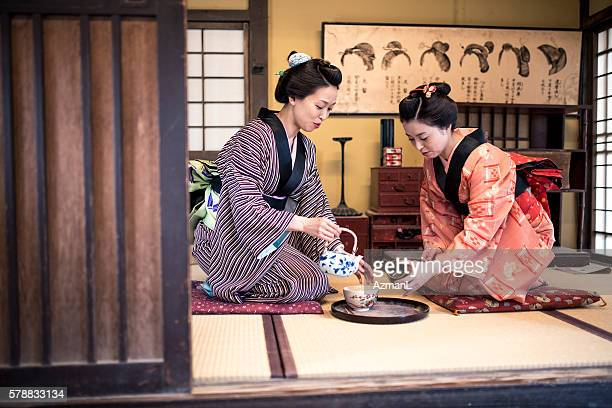 let me pour you tome tea - japan stock pictures, royalty-free photos & images