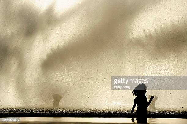Letcia Garcia tries to avoid the spray from a water show during a warm winter day at Waterfront in San Pedro Sunday There is a fountain at Waterfront...
