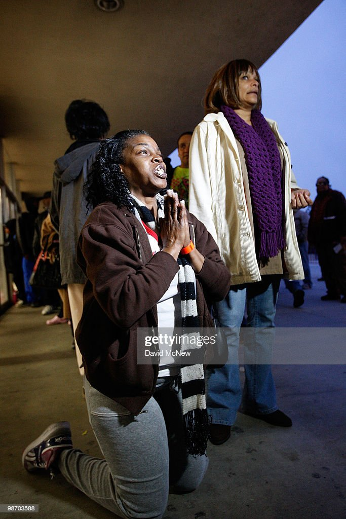 Leticia Brown kneels to express her joy and thankfulness for the opportunity to receive badly needed dental care as she waits in line for free healthcare service at the Remote Area Medical (RAM) clinic at the Los Angeles Sports Arena on April 27, 2010 in Los Angeles, California. More than 6,000 people were given wristbands over the weekend, some of them waiting overnight, to receive the free medical, dental and vision care. RAM hopes to treat 8,400 patients at the event which runs from April 27 to May 3. A Los Angeles-area RAM event in 2009 provided more than 14,500 services to approximately 6,344 patients. Los Angeles is reportedly home to 2.2 million uninsured people.