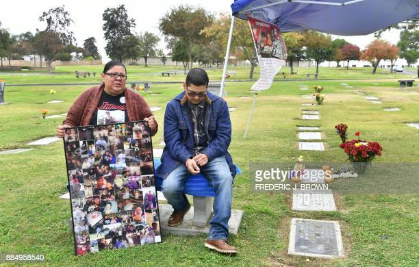 Leticia De la Rosa and nephew Joe Arambulo visit the grave of her son James on November 17 2017 in Bakersfield Kern County California James was...