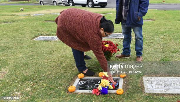 Leticia De la Rosa places a rose on the grave of her son James on November 17 2017 in Bakersfield Kern County California James was reportedly killed...