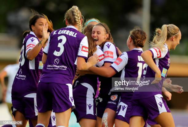 Leticia McKenna of the Perth Glory celebrates with her team after scoring the first goal of the game during the round seven WLeague match between the...
