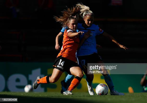 Leticia McKenna of the Roar competes for the ball against Ellie Brush of Sydney FC during the round eight W-League match between Sydney FC and the...