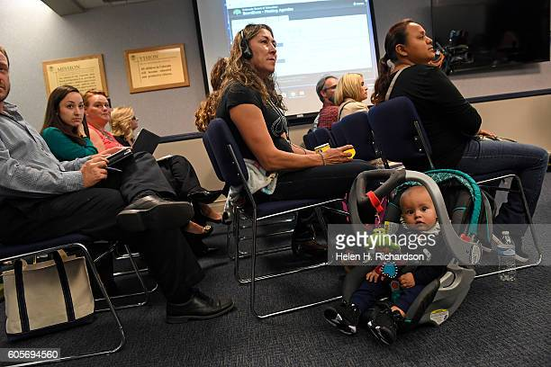Leticia Ramirez sitting with her 8 month old nephew Owen Cardenas listens to public comments during a hearing to end Colorado's 7 year ban on diet...
