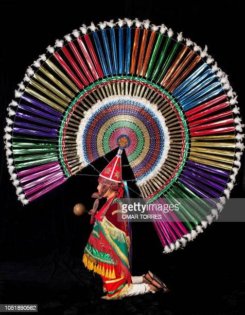 Leticia Uribe Hernandez poses for a photograph with her Penacho during the presentation of the Huey Atlixcayotl Festival on September 29 2018 in...