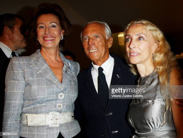 Letizia Moratti Giorgio Armani and Franca Sozzani attend the VOGUE Fashion's Night Out at the Giorgio Armani boutique on September 10 2009 in Milan...