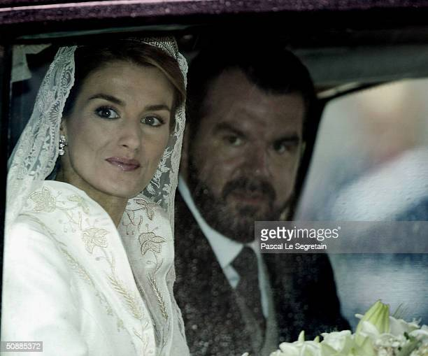 Letizia Ortiz and her father Jesus Ortiz arrive to Almudena cathedral moments before she marries Spanish Crown Prince Felipe de Bourbon May 22 2004...