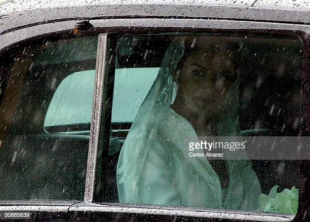 Letizia Ortiz arrives to Almudena cathedral moments before she marries Spanish Crown Prince Felipe de Bourbon May 22, 2004 in Madrid.