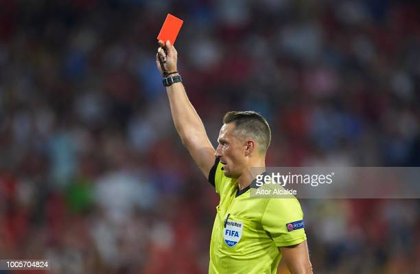 Letonian referee Andris Treimanis shows red card to Pauljevic of Ujpest during Sevilla v Ujpest UEFA Europa League Second Qualifying Round 1st leg...