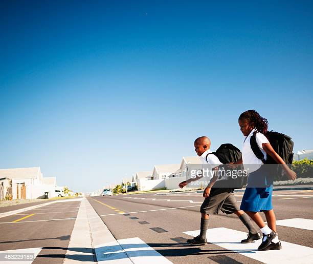 let's cross over - pedestrian crossing stock photos and pictures