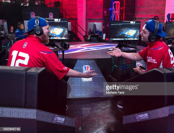 Lets Get It Ramo highfives JosephTheTruth of Pistons Gaming Team during the game against Knicks Gaming on July 20 2018 at the NBA 2K Studio in Long...