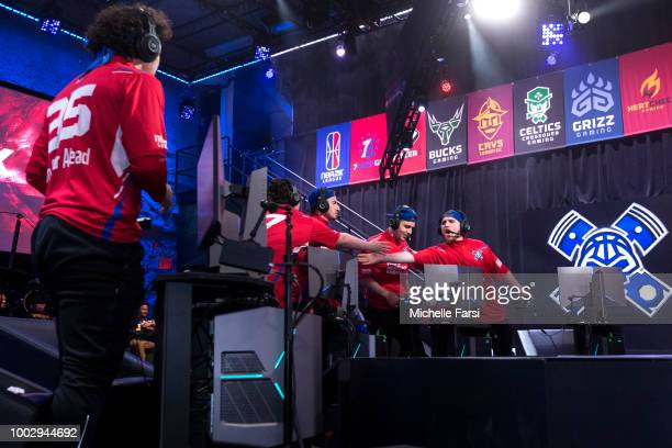 Lets Get It Ramo of Pistons Gaming Team highfives teammates during the game against Knicks Gaming on July 20 2018 at the NBA 2K Studio in Long Island...
