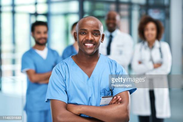 let's get you feeling good again - male nurse stock pictures, royalty-free photos & images