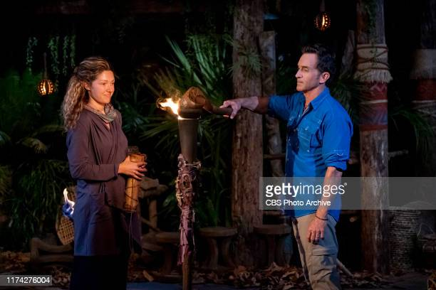 """Let's Play!"""" - Jeff Probst extinguishes Molly Byman's torch at Tribal Council on the second episode of SURVIVOR: Island of Idols airing Wednesday,..."""