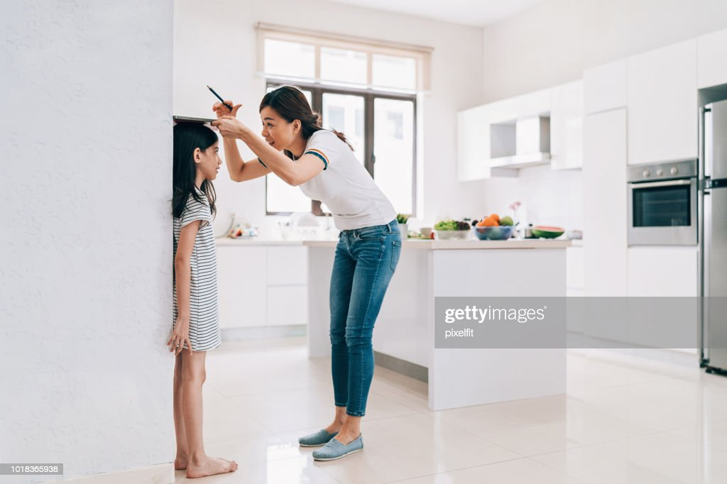 Let's see how much you have grown! : Stock Photo