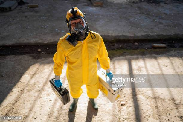 let's see what happen here - protective suit stock pictures, royalty-free photos & images