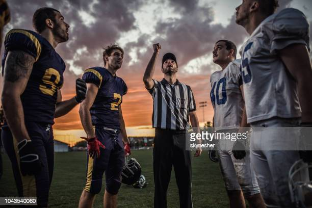 let's see who will play first! - american football referee stock pictures, royalty-free photos & images