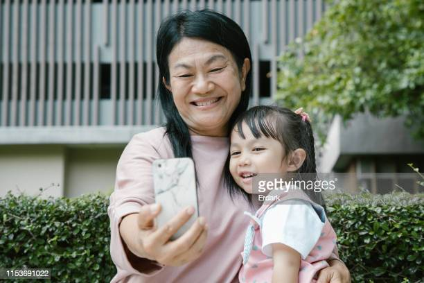 let's send this one to friends - asian granny pics stock photos and pictures
