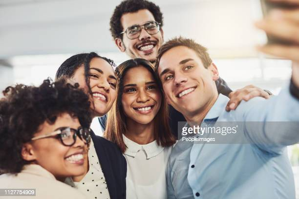 let's take a selfie of the best team ever - organized group photo stock pictures, royalty-free photos & images