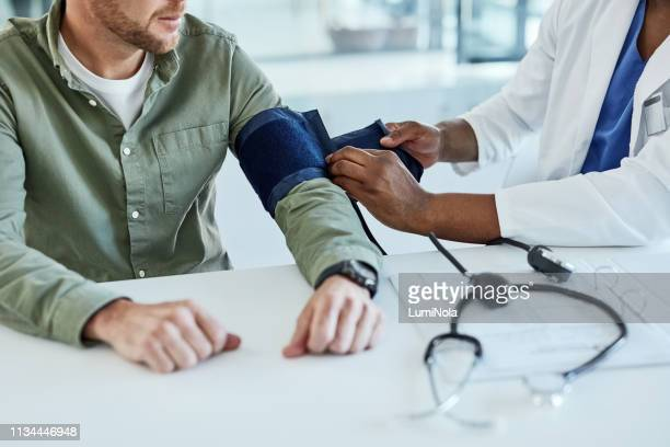 let's take your blood pressure reading - blood pressure gauge stock pictures, royalty-free photos & images